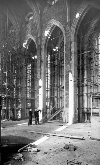 Photograph of the interior of the Nave during construction, showing the arches clad in scaffolding
